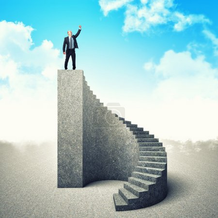 Photo for Businessman on the top of concrete stair - Royalty Free Image