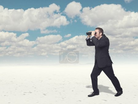 Photo for Businessman loo with classic binoculars - Royalty Free Image