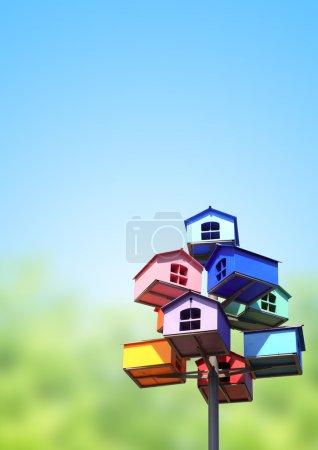 Photo pour Des nichoirs colorés sur ciel bleu - image libre de droit