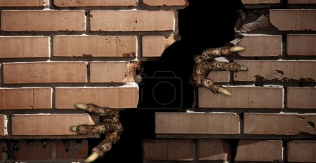 Paws of monster , breaking a brick wall