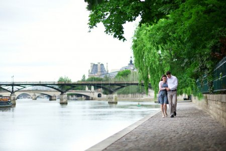 Photo for Romantic dating couple is walking by the water - Royalty Free Image
