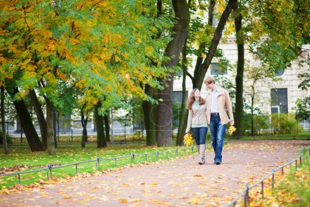 Happy young couple enjoying beautiful autumn day