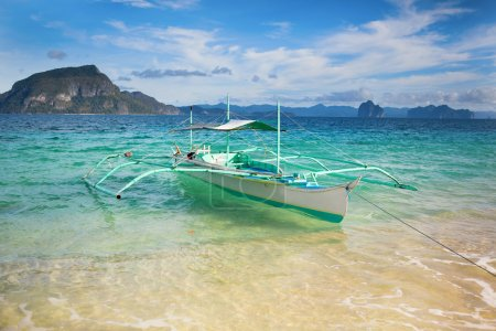 Outrigger boat on a perfect tropical beach
