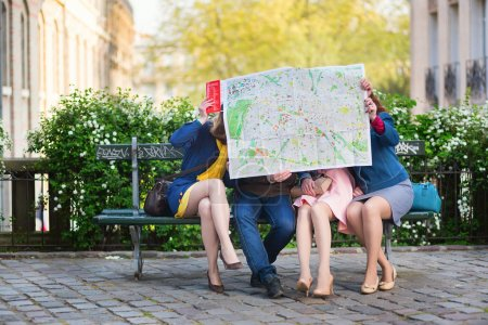Tourists looking in map