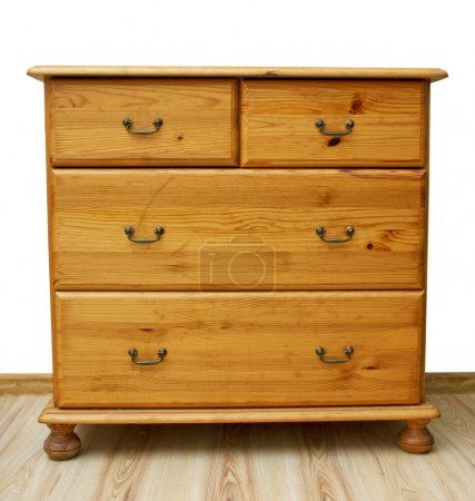 Photo for Aged chest of drawers into new flat. - Royalty Free Image