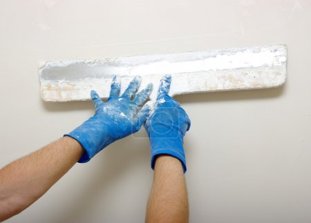 Photo for Master makes plaster on a wall - Royalty Free Image
