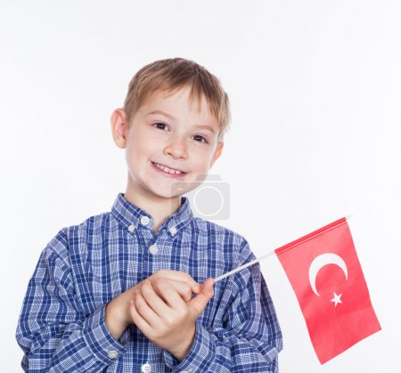 A little boy with Turkish flag on white background