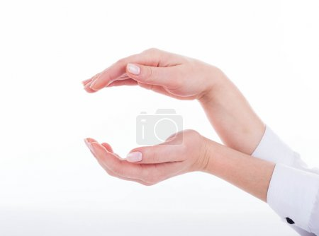 Photo for Female hands forms care symboling on white background - Royalty Free Image