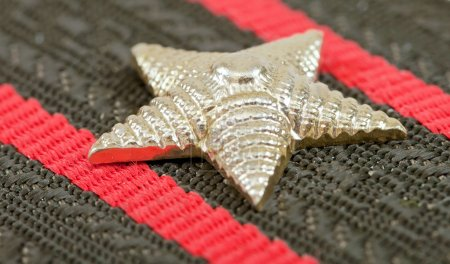 Star on the Shoulder strap of russian army officer close up