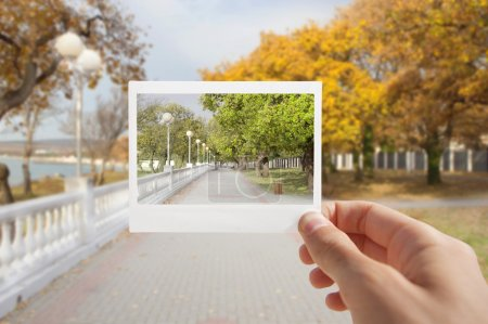 Holding Instant Photo.