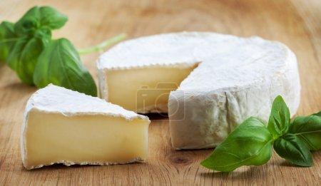 Camambert cheese on wooden cutting board...