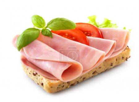 Photo pour Sandwich avec jambon de porc sur fond blanc - image libre de droit