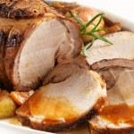 Roasted pork on white plate...