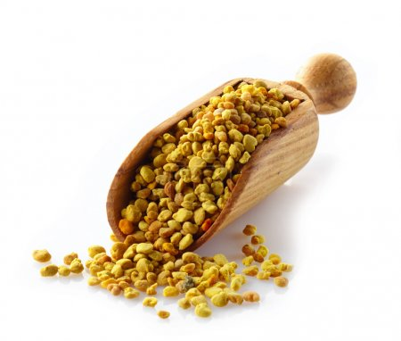 bee pollen in a wooden scoop