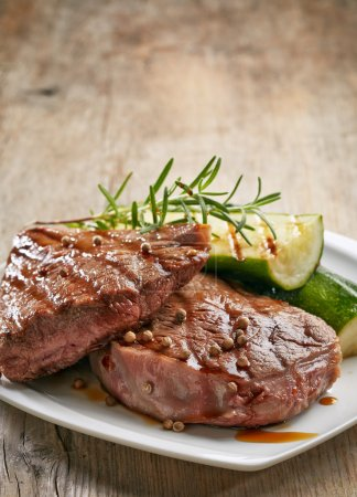 grilled beef steak on white plate