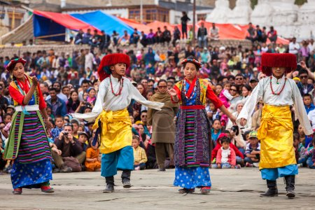 Young dancers in traditional Ladakhi Tibetan costumes perform fo