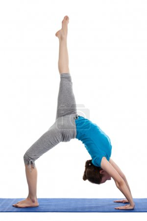 Photo for Young beautiful woman doing yoga asana excerise - Royalty Free Image