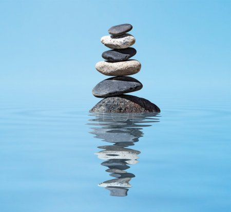 Photo for Zen balanced stones stack in lake with reflection - Royalty Free Image