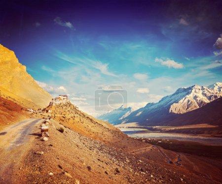Photo for Vintage retro hipster style travel image of  road to Kee (Ki, Key) Monastery. Spiti Valley,  Himachal Pradesh, India - Royalty Free Image