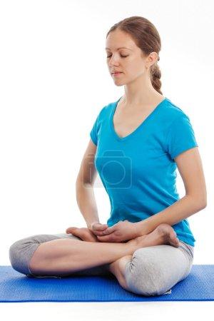 Yoga - young beautiful woman doing yoga asana excerise