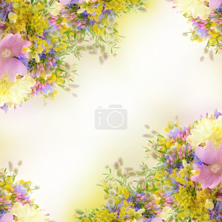 Photo for Frame from summer flowers over white with bokeh and copy space, floral background - Royalty Free Image