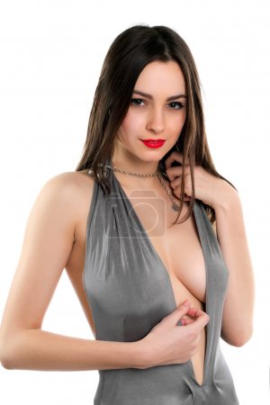 Portrait of sexy brunette wearing grey dress with ...
