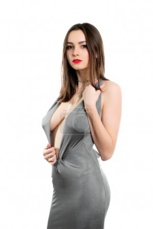 Young alluring lady wearing sexy grey dress. Isola...