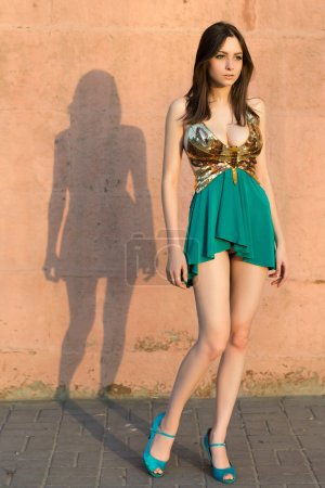 Photo for Thoughtful leggy woman posing in frank dress outdoors - Royalty Free Image