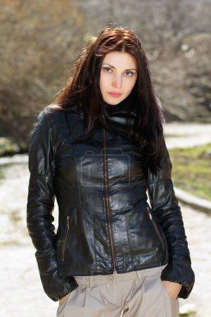 Pretty brunette wearing jacket