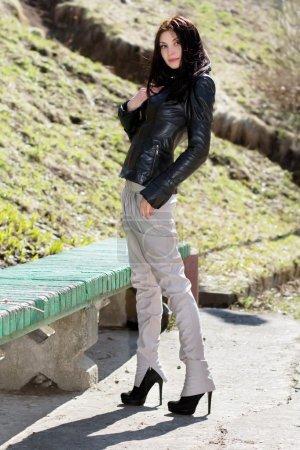 Brunette in light pants