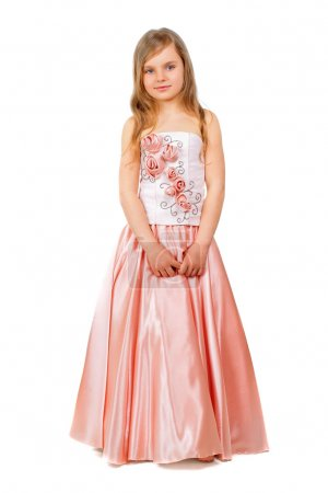 Photo for Beautiful little girl wearing nice peach dress. Isolated on white - Royalty Free Image