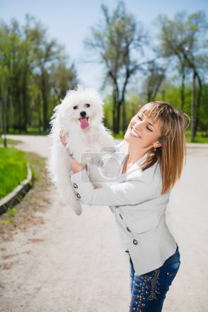 Smiling woman with a dog