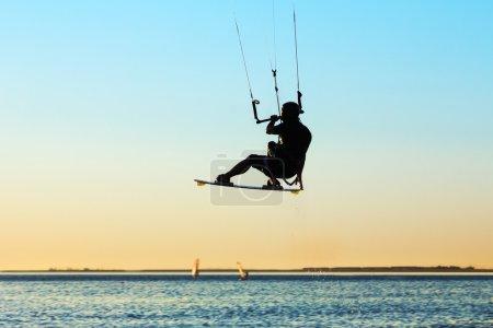 Silhouette of a kitesurfer