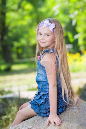 Photo for Portrait of little girl posing on the stone - Royalty Free Image