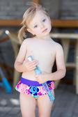 Little blond girl in water pool