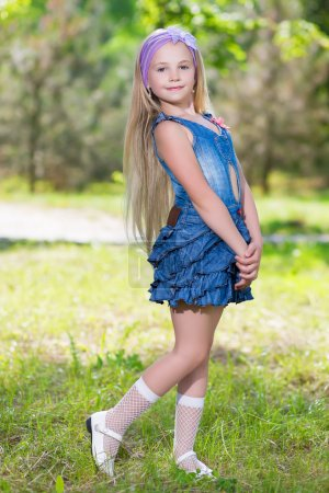 Photo for Nice little girl wearing blue jeans dress - Royalty Free Image