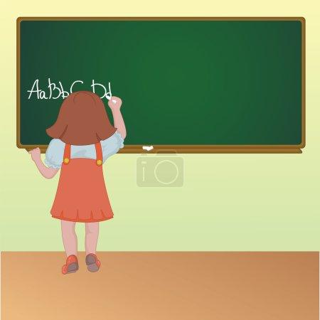 Little schoolgirl writing on a blackboard