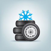 The set of winter wheels with icon of snowflake