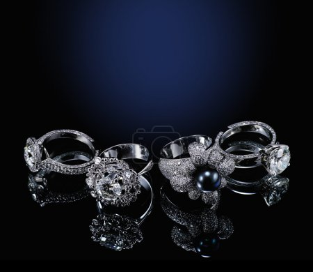Photo for Collectionsof rings with diamond isolated on black background - Royalty Free Image
