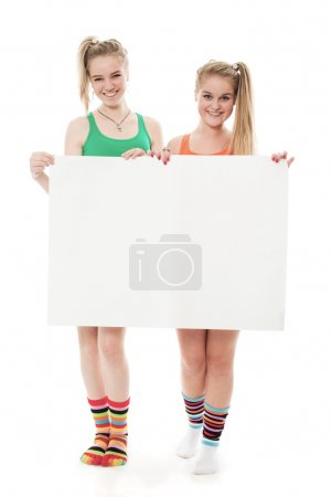 Two cheerful girls hold the form