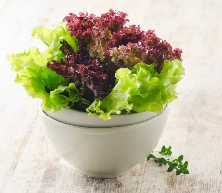 Lettuce salad on a wooden table...
