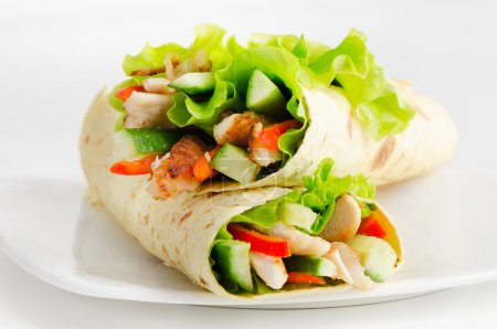 Photo for Tortilla wraps with chicken and fresh vegetables - Royalty Free Image