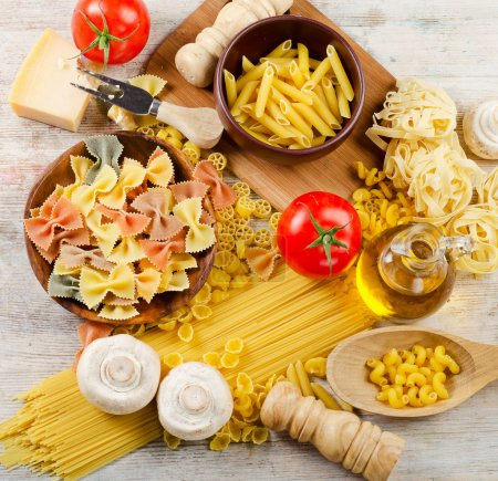 Photo for Italian pasta with tomatoes and mushrooms - Royalty Free Image