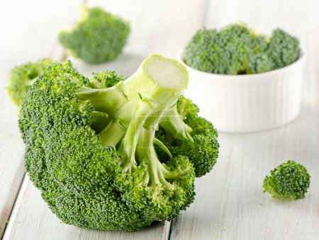 Photo for Broccoli on a wooden table. Selective focus - Royalty Free Image