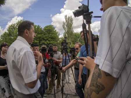 Photo for Rector Vitaly Komarnicki answering journalists' questions. Parents of students of 1-2 courses of Lugansk State University of Internal Affairs named Edouard Didorenko require rector Vitaly Komarnicki  not send cadets to practice in Odessa and Nikolaev - Royalty Free Image
