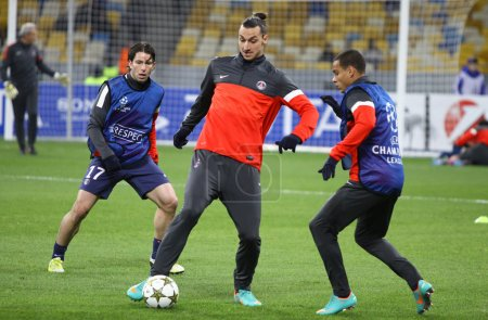 FC Paris Saint-Germain players fight for the ball during trainin