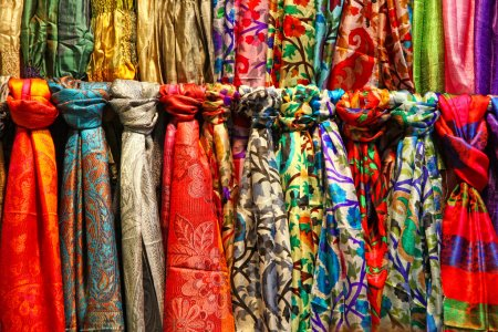 Colourful silk scarfs hanging at a market stall in Istanbul
