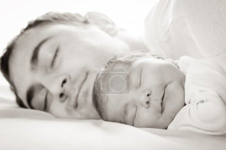 Photo for Father do everyday exercises and massaging with baby - Royalty Free Image