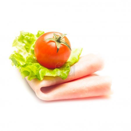 Photo for Fresh rolled ham slice and lattuce with cherry tomato isolated on white - Royalty Free Image