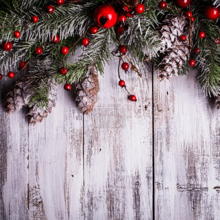 Photo for Christmas border design with snow covered pinecones - Royalty Free Image